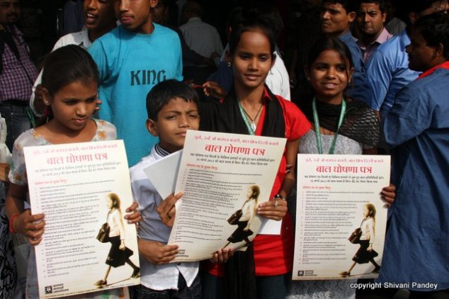 Children with drafted manifesto in their hands