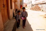 Two boys returning from school